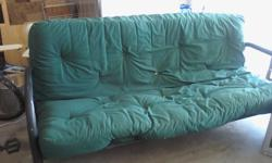 3 Year old Full Size Bed Futon with Black Metal Frame. Cover is Hunter Green and zips off for complete washing.