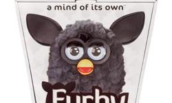 FURBY 2012 BLACK A MIND OF ITS OWN!   NEW in factory sealed package!   Decked out in ten brilliant new colors, the newest FURBY is definitely dressed for success, but this FURBY in black has maybe the most versatile coat ? does black ever