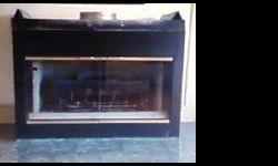 gas fireplace insert its dbl sided so the back looks like the front heat 2 rooms with one fireplace its in very good shape.