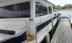 50 Ft. Gibson Crusader Houseboat with a Twin 454 Crusader and Kohler Generaator located in Mountain Home AR. at Lake Norfolk. Remodeled from ceilings, walls, cabinets, counters ect. has a master bedroom in back and two queen beds in loft, 1 1/2 bathrooms