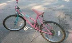 """Huffy girl's bicycle. 20"""" mountain tread tires, hand brakes, multispeed gears, kick stand, several reflectors. Used at only $25.00."""