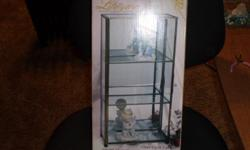 this glass cabient has never been opened or used or anything. and its good for puting colocates items in.