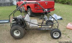 "a 10 horse power motor, full roll cage, KC lights, and key start. Runs good just needs breaks. Fun toy. Must go fast, I""m moving"