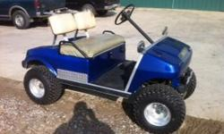 Golf cart lifted with aluminum wheels (gas).