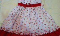 Beautiful little summer dress. Has elastic straps, back zipper and attached fabric ties.