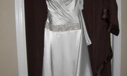 Brand New never been worn with tags still on it. Gorgeous Ivory satin halter trumpet style gown from David's Bridal Galina Signature series. Fits beautifully. Has small train that can be bustled for reception. Size 2- Very glamorous and old hollywood Been