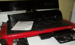 this is a new grittle with a back splash guard never used red bought from ginney;s catalog