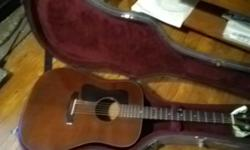 Has a few blemishes since a 1970s vintage guitar.  The age really comes out in the rich tones it has.  The bridge and neck sre in fine shape so the action is still low as you would want it, making it easy to play.  Dark brown color makes it