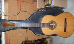 yamaha clarinet and acoustic guitar