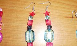 these handmade jewelry earrings i am making different kinds of earrings like medium ones and small ones. the small ones are $10.00 each and the long was are $15.00 if interested email me at grace_sinkuler@yahoo.com and i will be happy to help in anyway i
