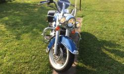 2006 Harley Davidson Road King.. 39,000 miles excellent condition garage kept.Chopper Blue with led light kit. Must see loaded lots of chrome vansin Hines pipes.. Will not trade