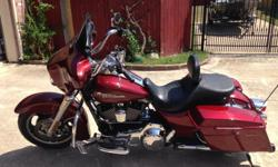 ONE OWNER, GARAGE KEPT, LOW MILES, NEVER DROPPED OR WRECKED Aftermarket Accessories: Rhinehart pipes, mini ape handlebars, seat with removable back rest, also have the original seat, braided cables. MILES: 9181 FLHX Street Glide features: Rubber mounted