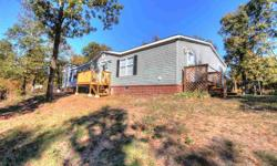 Own your own home and land with gorgeous views right outside of Conway! Very large 2,100 Sq Ft 3Bed 2Bath manufactured home features Wood Burning Fireplace, Upgraded Cabinets, Large Kitchen with Island, Breakfast Area, Formal Dining Room (or Office),
