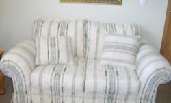 This furniture is still in great shape the loveseat is like brand new. The color is cream with a little olive green stripes. The material is very good wipes off nice.