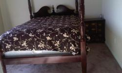 A high four post oak bed with pillow top mattress for sale. Along with night stand. Excellent condition...