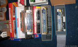 HO scale trains, approx. 25 structures, 7 locos, 1 dummy, 2 controlers, 18 l/r turnouts, powered and manuel. 30 ft. of track, all types of repairs and assoc. has been run for aprox 1.5 months. valued at1100.00. cars and trains all in org boxes.
