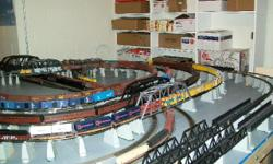 Have massive HO train layout with over 400 cars, 56 passenger cars and 50 engines along with 700 pieces of track and scores of switches..Mostly athearn cars and engines also broadway limited and rivarossi engines and cars. Also have buildings, vehicles