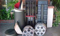 "2 Hollywood 35mm movies: ""Bury Me an Angel"" (2 reels) and ""The Great Gun Down"" (3 reels). Sun Releasing, Hollywood General Studios. Also, portable backdrop in a wheeled carrying case for the frame. 8x8. In the round case is the red heavy panels to hang on"