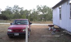 3 bdrm 2 bath mobile home located on 6 city lots. Home and property both need work but is ready to live in now. City water and sewer. Also has built on attached metal roof. Has new tubs, sinks, plumbing (quest) Good rental property. Less than 1 mile from