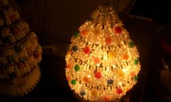 Home made Christmas trees made out of safety pins and beads.