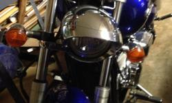 Beautiful metalic cobalt blue finish. This is nothing but a fun and powerful bike.  A 2005 with 8000 Miles.