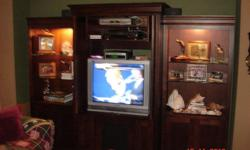 """Three piece Hooker Entertainment Center in excellent condition. Two end units are 32"""" x 78"""" with lites, doors and glass shelves. Center unit is 42"""" x 83"""" with closing drawers and DVD storage. Cherry veneers with maple solids. This was a $3000 + unit. Will"""