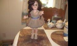 IDEAL DOLL, SHE IS IN GREAT SHAPE. SHE HAS EVERY THING THAT SHE CAME WITH. DRESS,SOCKS,SHOES,BOW,HAIR NET.  HER LEGS AND ARMS MOVE. HER EYES SHUT AND OPEN. SHE HAS ON THE BACK OF NECK ,,IDEAL 90W.  WAS TOLD THAT SHE WAS IN