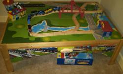 Imaginarium train set (60 pieces) and table.  Excellent condition.  Perfect gift for Christmas.