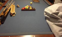 American Heritage wooden pool table with blue felt. Comes with sticks, extra tips( that goes on the sticks, brushes, the works!!!! We need this gone due to an expanding family. We hardly ever use it maybe 1 time a year. This is a great buy actual retail