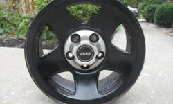 Jeep Wrangler 15 in black spoke wheels with center emblem