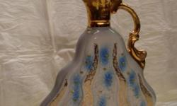 THIS VINTAGE JIM BEAM DECANTER IS IN GREAT CONDITION FOR BEING DECADES OLD AND GLEAMS BRIGHTLY WITH GOLD DECORATION WWW.TOPHATSELLS.COM