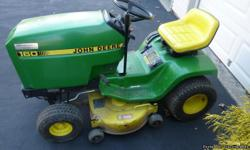 John Deere 160 For sale a John Deere 160 lawn tractor complete with a 38? mower deck, rear bagger / new bags, plow blade, tire chains, and weights. Tractor runs good and uses no oil.