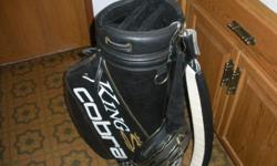 Black leather oversized bag with club cover and three-point carry strap. Beautiful. Only used 5 times.