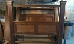 Solid walnut hand crafted bed. 6 inch square posts, 6 1/2 feet high. Recessed panels on both headboard and footboard.