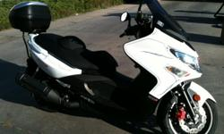 2008 Kymco Xciting 500 RI Scooter with custom paint, GIVI back box (trunk), and cover. Less than 3000 miles. It looks and runs great!
