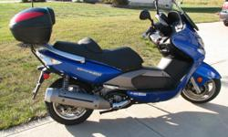 2007 Kymco Xciting 500 cc scooter. It has 4073 miles on it and a Givi top case and it gets 50 mpg.I ended up buying a motorcycle so my wife and I could ride together on trips,So that is why I am selling it.