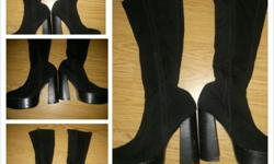 Size 7 1/2..8 boots. Big high heels go up to knee. If interested text ()-..thanks