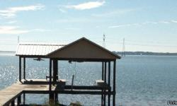 Lot 98, LCR 908, Jewett, Tx This waterfront property has a 960+ sq. ft., 1 bed, 1 bath 1 ½ story cabin on the main lake, built in 2002, open floor plan, carpet/vinyl floors, all appliances & furnishings convey, great view of lake from porch, storage