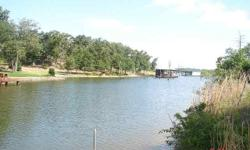 PR off Winding Way, Thornton, Texas This 1.01 acre waterfront lot is in a protective deep cove, just off the main lake, the property is in a cul-de-sac, fenced on one side, secluded, quiet area, plenty of shade trees, electric available at road and close