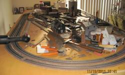 I have a large train set for sale. There are Eleven diesels, U-33, GP-30, Gp-38-2, and 1 steam switcher 0-6-0. There is 9 building plus several that I haven't built yet. Lot of snap track. A4'x8' layout about half built. Roadbed and trak laid and