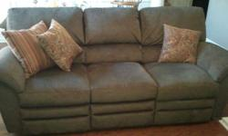 Purchased new 2yrs ago, paid $1200.  Beautiful dark olive green fabric. Excellent condition. No smokers, no kids, no pets.
