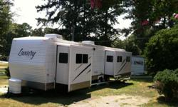 Like new 2009 40ft Luxury By Design camper trailer has three electric slides, fireplace, w/d, central air w/additIonal a/c in bedroom, very spacious living room, fold out couch makes queen bed, garden tub, vanity bathroom, its very clean, there has been