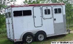 Two horse and built for extra large horses. Is taller and longer than the average trailer with a tack and/or dressing area in the front. Bumper pull. I bought this as a retirement present for myself and was then not able to use it much