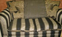 Pretty black and gold loveseat with reversable pillows. Please call Susie at 405-206-3353.