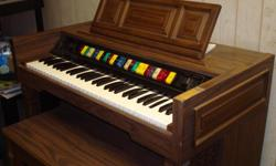 Great organ in good condition. Good for anyone looking to start playing the organ or piano. Organ comes with sitting bench. Walnut color. Wonderful for the whole family to enjoy.