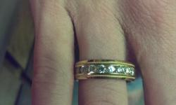 1 carat 14k yellow gold Diamond wedding band. Never worn. Paid. $1950. Price neg.