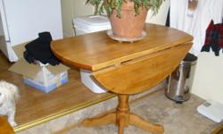 3 foot circlular drop leaf table excellent for small dinning area's. maple finish