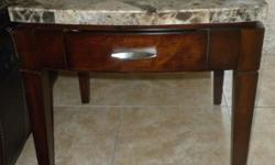 BRAND NEW IN BOX GRANITE END TABLE. RETAILS $171.00 AT OAK EXPRESS (FURNITURE ROW) ASKING $100.00 OR BEST OFFER. PICK UP ONLY. CALL IF INTERESTED. LOCATED  OFF OF COLONIAL DR IN CORNER LAKES ESTATES.