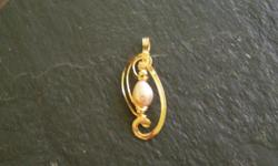 This pendant is handmade wire sculpture ,I used mauve pearl,gold filled balls,14/20 gold filled wire. if you like what you see please call me at x 10 or visit www.mgjewelry4u.com.I can make pendants with your choice of stones or stone of your