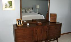 This is a compete Broyhill Brasilia bedroom set in wonderful vintage condition with very clean fronts, tops surface and sides. It includes a stunning Mid Century Modern vintage retro triple dresser. This furniture appreciates in value over time if
